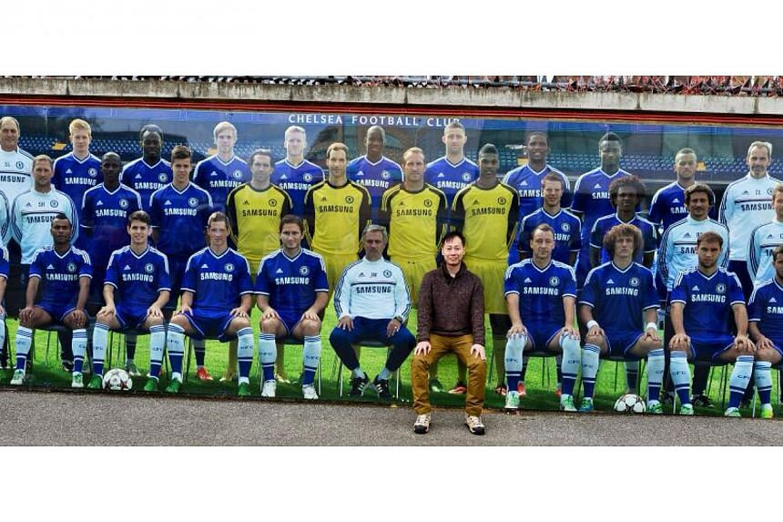 Top prize winner of The Straits Times Wherever You Are contest Tung Hon Keng, 47, posing for a mock photo with Chelsea players. The engineering manager won a host of prizes for his skyline photo, including $3,000 in cash, return flights to London and