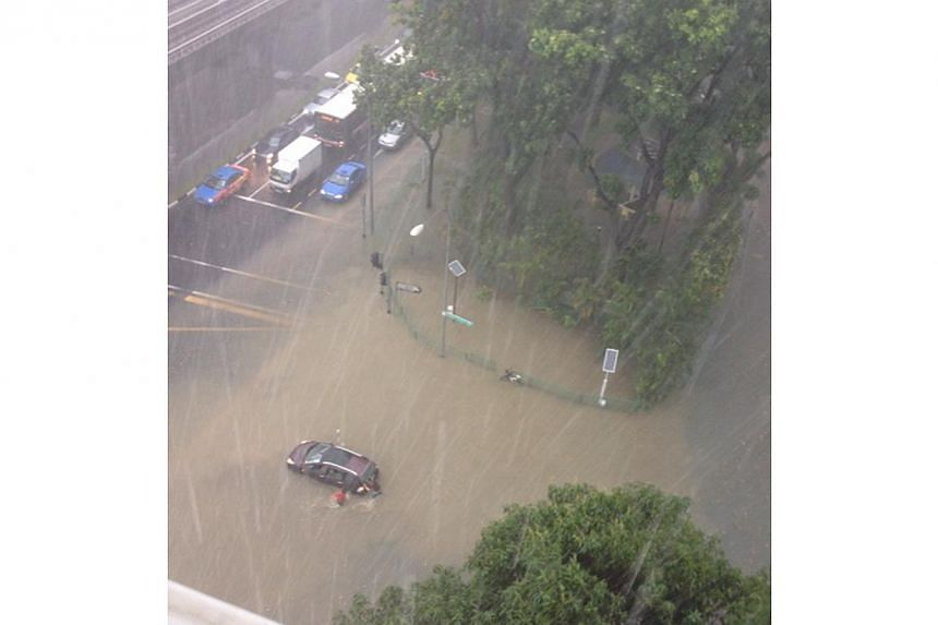 Flash floods hit Chai Chee on Monday afternoon after a heavy downpour, leaving some vehicles stranded. The flood at the junction of New Upper Changi Road and Chai Chee Road made the roads, at one point, impassable to traffic. -- PHOTO: STOMP