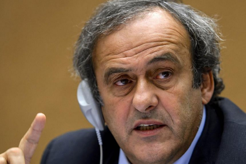 Uefa chief Michel Platini (above) wants the World Cup finals expanded to 40 teams from 2018 to allow more African and Asian countries in the tournament but without reducing the number of European nations. -- FILE PHOTO: AFP