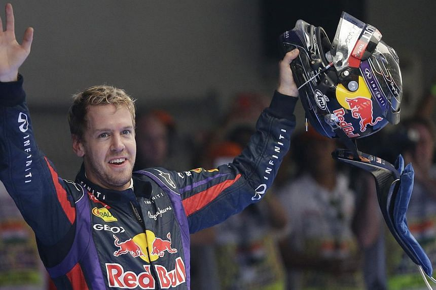 Red Bull driver Sebastian Vettel of Germany waves to the crowd after winning the Indian Formula One Grand Prix and his 4th straight Formula One world drivers championship at the Buddh International Circuit in Noida, India on Sunday, Oct 27, 2013.&nbs