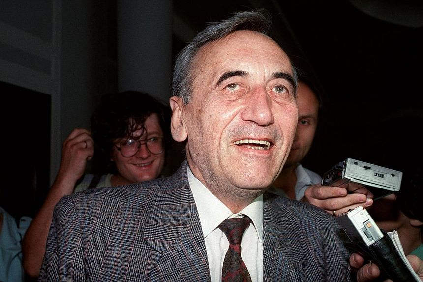 Mr Tadeusz Mazowiecki smiles as he leaves the Diet, the Polish Parliament, after a meeting with Solidarity parliament members in Warsaw, on Aug 19, 1989.Mr Mazowiecki,a former Polish prime minister who was the first non-communist head of