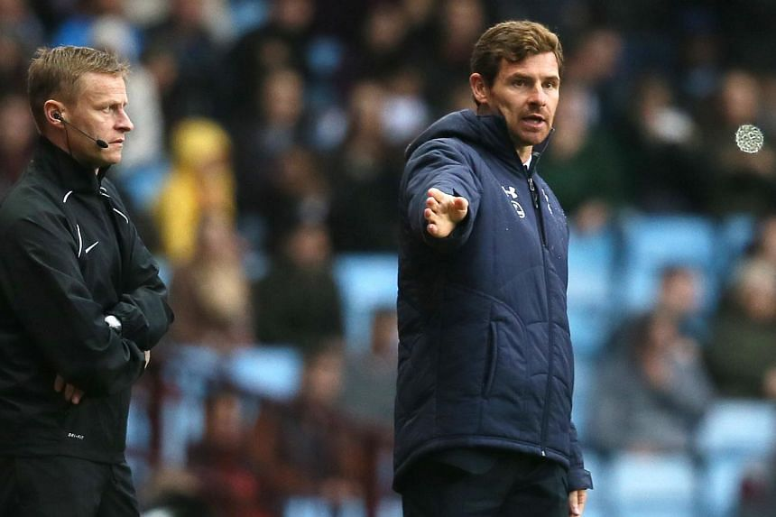 Tottenham Hotspur's manager Andre Villas-Boas (right) directs his team from the touchline as they play Aston Villa during their English Premier League soccer match at Villa Park stadium in Birmingham, England, on Oct 20, 2013. Manager Andre Vill