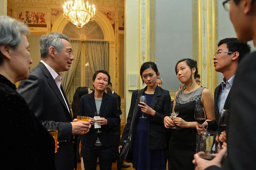 PM Lee Hsien Loong and Ho Ching speak to Singaporean students, (from left) Karen Chia, 37, Joanne Tan, 23, Krystal Lee, 23, Xiu Wei, 25, and Wu Shuang, 23, during a tea session at Shangri-La hotel, 27 October 2013. The tea session was attended by Sin
