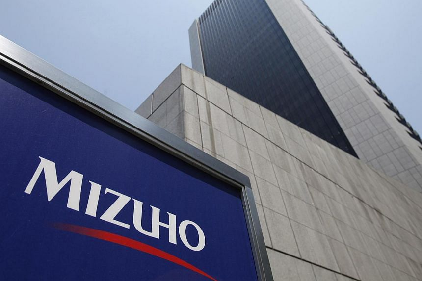 Mizuho Financial Group's Mizuho Bank headquarters is pictured in Tokyo in this May 18, 2011 file photo. Mizuho Financial Group will try to put a loans-to-mobsters scandal behind it on Monday, but while Japan's second-biggest bank by assets may