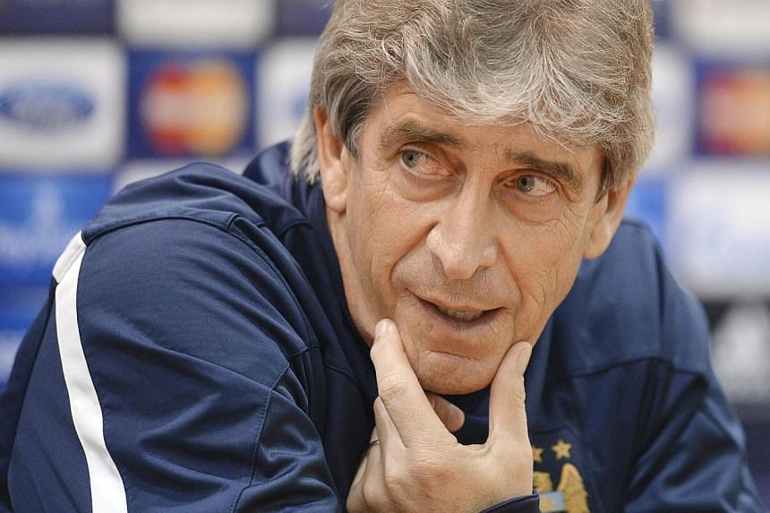 Manchester City's coach Manuel Pellegrini attends a press conference in Moscow on Oct 21, 2013, a day ahead of their UEFA Champions League group D football match against CSKA Moscow. Manchester City manager Manuel Pellegrini walked straight down