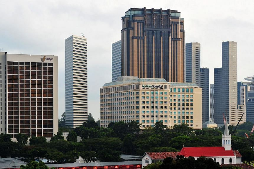 The Raffles Hospital on North Bridge Road. A rise in patient numbers gave Raffles Medical Group's earnings a shot in the arm in the third quarter of this year. -- ST FILE PHOTO: ALPHONSUS CHERN
