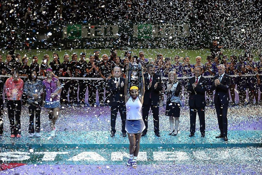 Serena Williams of the US celebrates after winning the WTA Championships final tennis match against China's Li Na on Oct 27, 2013. Serena Williams successfully defended her WTA Championships title on Sunday, beating Li Na, 2-6, 6-3, 6-0, to fini