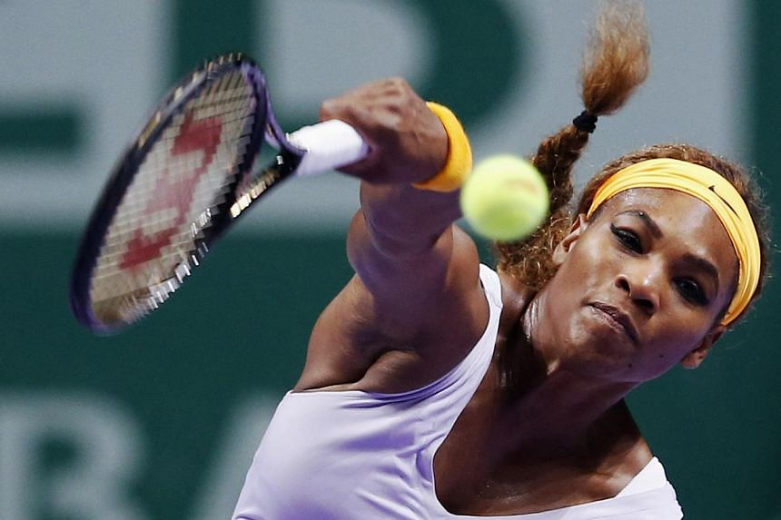 Serena Williams of the U.S. hits a return to Li Na of China during their WTA tennis championships final match at Sinan Erdem Dome in Istanbul, on Oct27, 2013. 2013. -- PHOTO: REUTERS