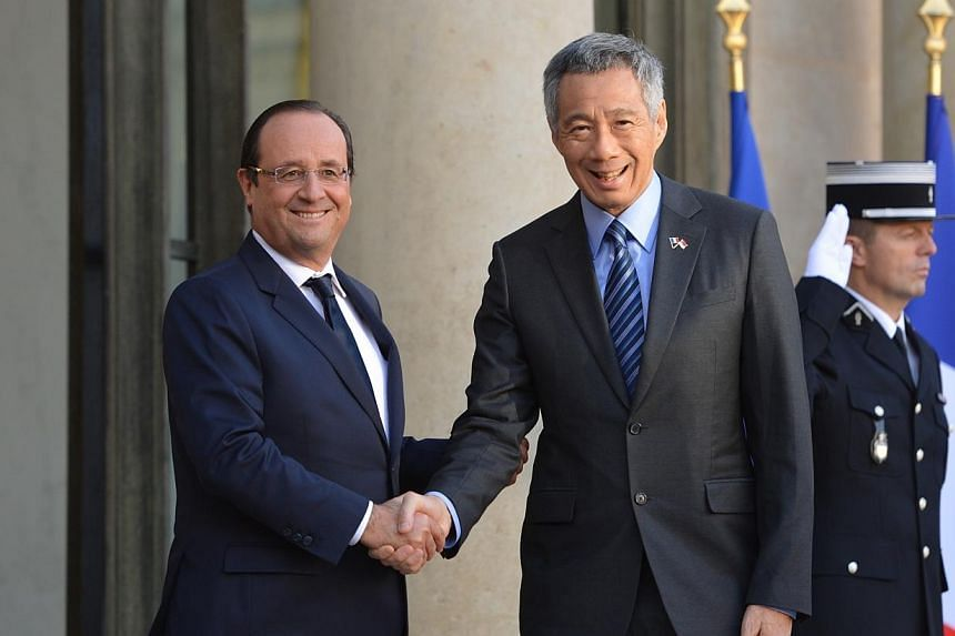 Prime Minister Lee Hsien Loong shakes hands with French PresidentFrancois Hollande. Mr Lee, whois in France for an official visit, called on Mr Hollande at the Elysee Palace on Monday afternoon. -- ST PHOTO: CAROLINE CHIA