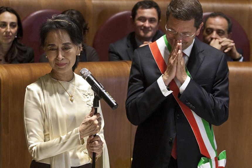 Ms Aung San Suu Kyi, Myanmar's Nobel Peace Prize laureate and long-time political prisoner, speaks as Rome mayor Ignazio Marino looks at her during a ceremony in which she received the honorary citizenship in Rome on Oct 27, 2013. Ms Suu Kyi collecte