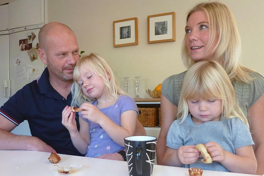 Swedish family Maerestad sit at their kitchen table in their home in Stockholm, Sweden on Oct 13, 2013. -- PHOTO: AFP