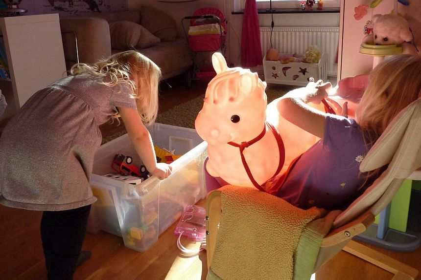 Swedish family Maerestad's children play in their room in their home in Stockholm, Sweden on Oct 13, 2013. Sweden had a head start in the good parenting debate as the first country to outlaw smacking but some argue that its child-centred approach has