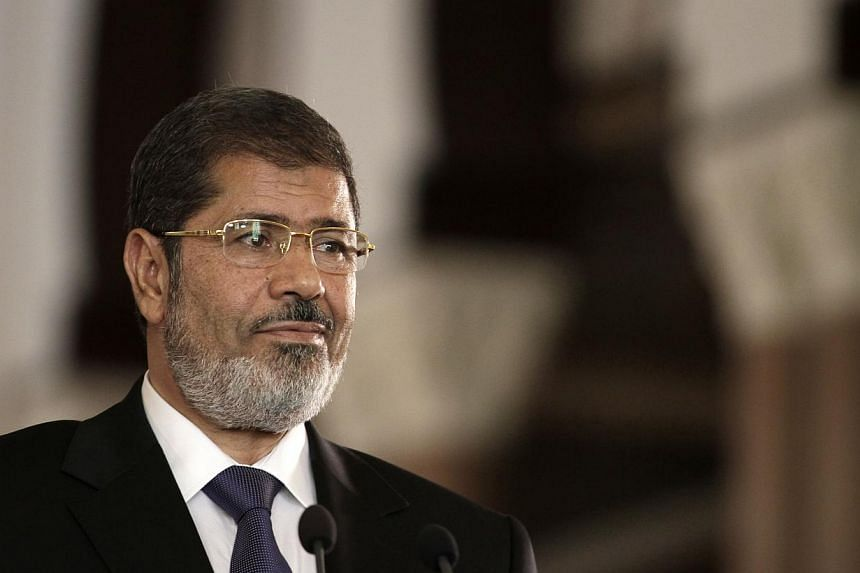 In this Friday, July 13, 2012 file photo, Egyptian President Mohammed Mursi holds a joint news conference with Tunisian President Moncef Marzouki at the presidential palace in Cairo, Egypt. Egypt's ousted president Mohamed Mursi has reject