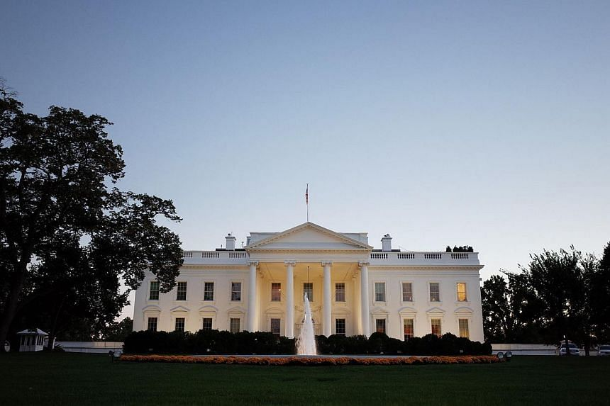 A Oct 20, 2013 photo shows the White House as seen from Pennsylvania Avenue as the sun sets on Oct 20, 2013 in Washington, DC.The United States Monday said it must better weigh the risks and rewards of its spying activities, as Europe fulminate