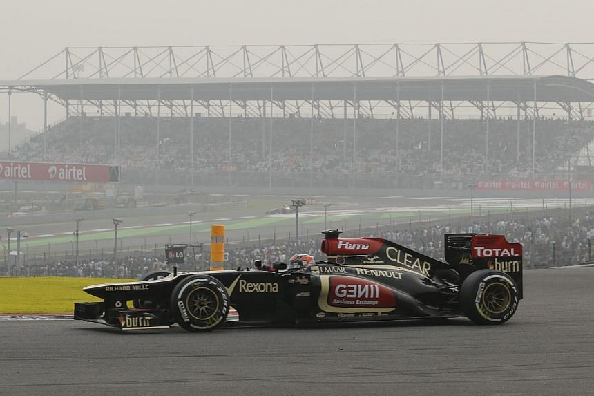 Lotus driver Kimi Raikkonen of Finland steers his car during the Indian Formula One Grand Prix at the Buddh International Circuit in Noida, India on Sunday, Oct 27, 2013. Lotus apologised yesterday for bad language in a heated exchange with thei