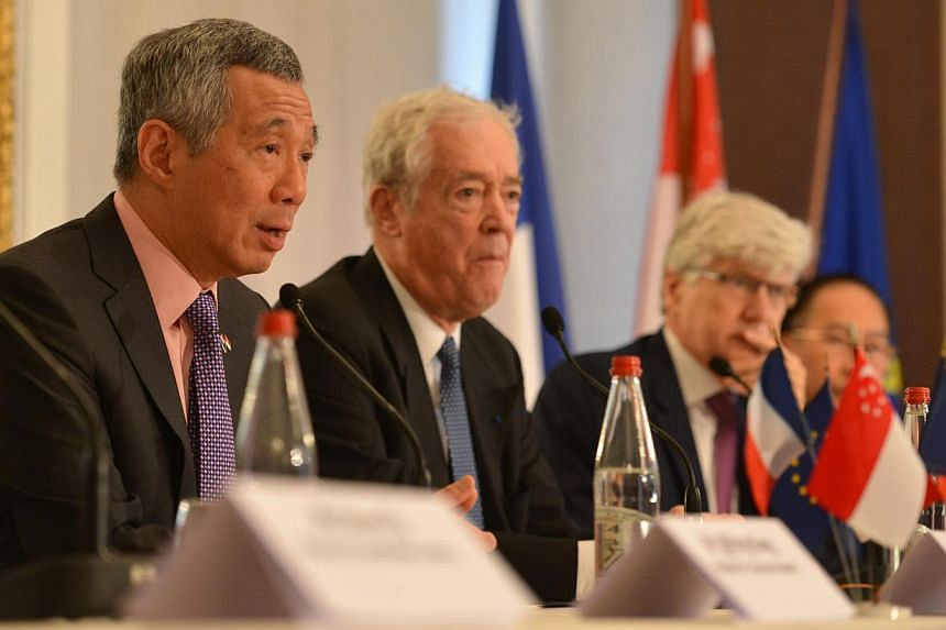 Prime Minister Lee Hsien Loong speaks at the France-Singapore Business Forum hosted by Medef International in Paris on Tuesday, Oct 29, 2013. Seated with him (from left) are Mr Jean Burelle, chairman of Medef International, Mr Arnaud Vaissie from Int
