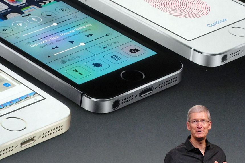 Apple chief executive Tim Cook praises the new iPhone 5S as the most refined model the company has ever introduced on Sept 10, 2013, in Cupertino, California. -- FILE PHOTO: AFP