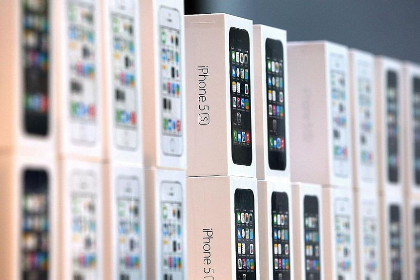Boxes of the new Apple iPhone 5S are displayed at an Apple Store on Sept 20, 2013 in Palo Alto, California. -- FILE PHOTO: AP