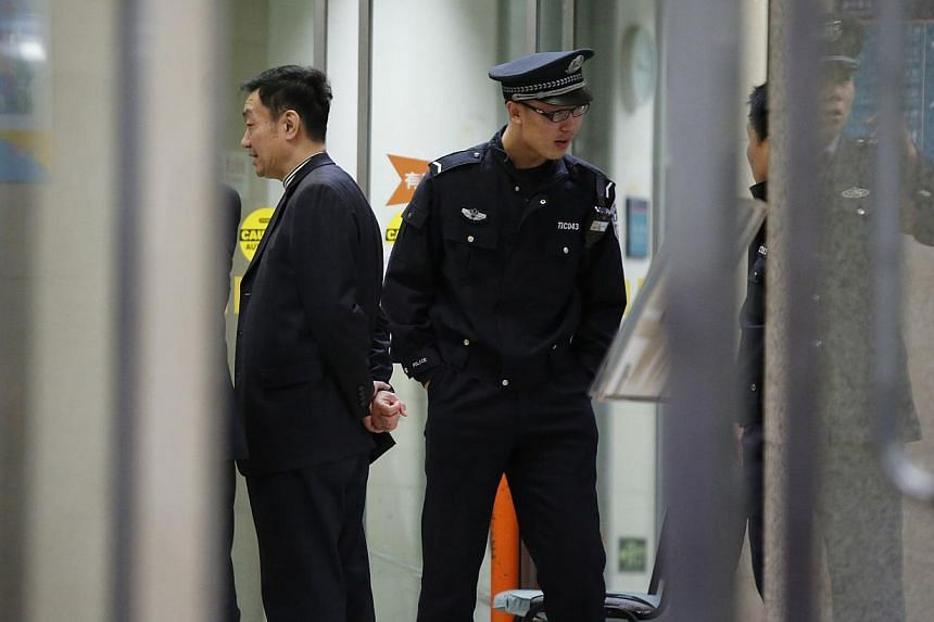 A police officer stands guards in front of EM Observation Ward at a hospital treating people injured from the car crash in Tiananmen Square on Monday, in Beijing on Oct 29, 2013. -- PHOTO: REUTERS