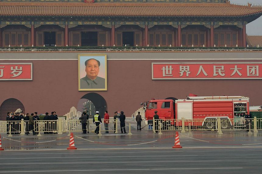 A fire truck stands parked before Tiananmen Gate and a portrait of Mao Zedong in Beijing on Oct 28, 2013 after a vehicle crashed near the area.