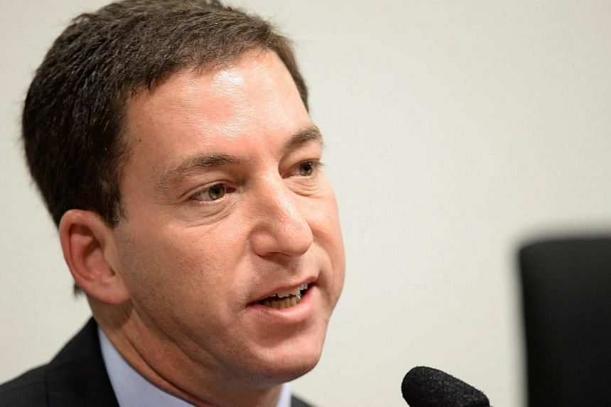 The Guardian's Brazil-based reporter Glenn Greenwald, testifies before the investigative committee of the Senate that examines charges of espionage by the United States in Brasilia on, Oct 9, 2013. Germany should protect former US intelligence contra