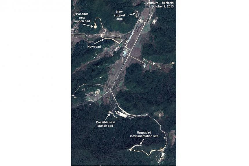 This Oct 9, 2013 satellite image taken by Astrium, and annotated and distributed by 38 North shows the Sohae site where North Korea launched a long-range rocket into space in Dec 2012. North Korea has undertaken major construction work at its main mi