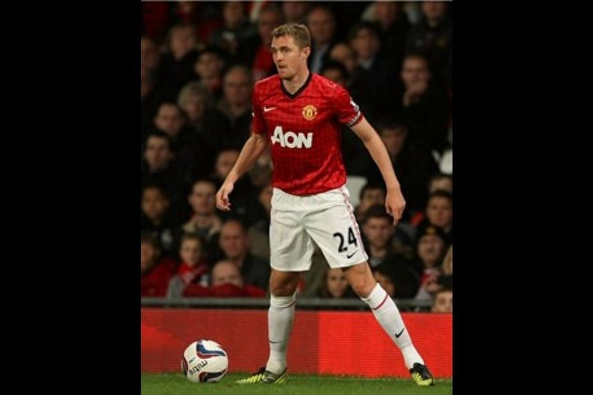Manchester United midfielder Darren Fletcher has made a return to competitive action, playing 67 minutes for the under-21 team as he battles back from a chronic illness.-- FILE PHOTO: MANUTD.COM