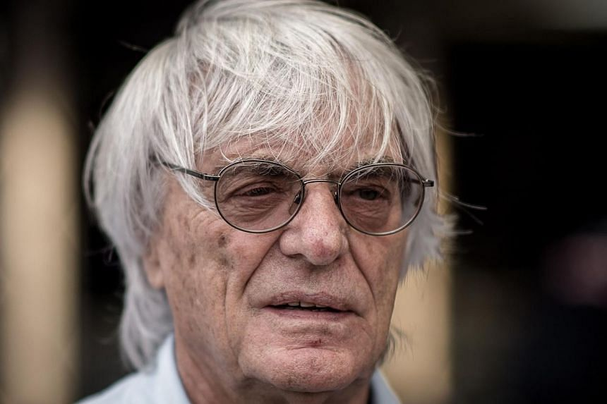 """Formula One boss Bernie Ecclestone at the Formula One Singapore Grand Prix on Sept 19, 2013. MrEcclestone was accused of making a """"corrupt bargain"""" that cost a German media firm millions in a London court on Tuesday, one of multiple legal chall"""