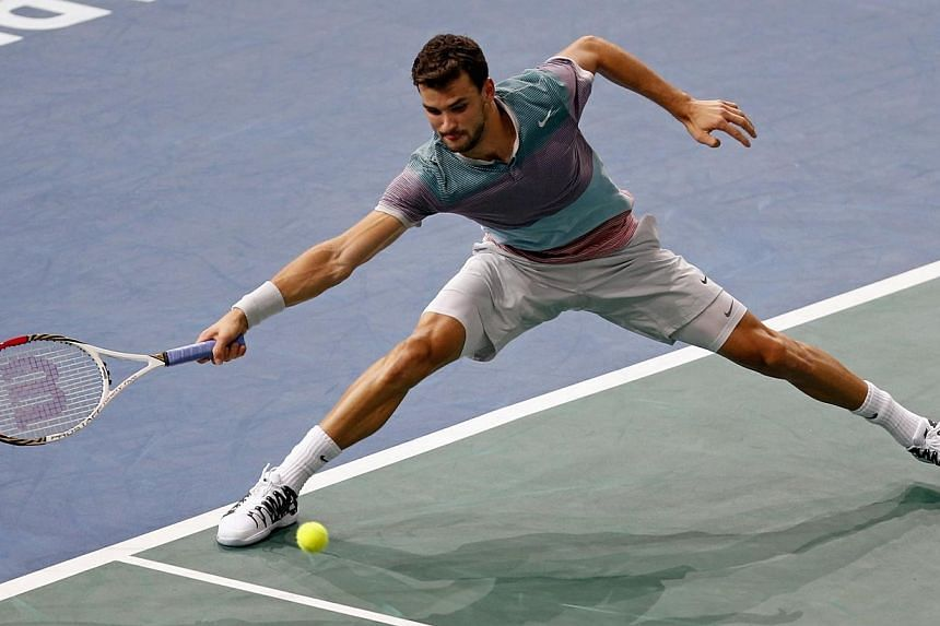 Grigor Dimitrov (above) of Bulgaria stretches to return the ball to Michael Llodra of France in their opening round match at the Bercy Tennis Open in Paris, Oct 29, 2013. Dimitrov continued his rich vein of form as he marched into the second rou