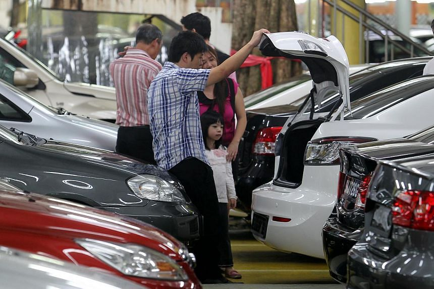 """Potential customers at a used car showroom at Turf City on April 6, 2013. Complaints from car buyers have crept up since the so-called """"lemon law"""" kicked in last year - though cases of irreparably defective vehicles remain rare, new figures show. --"""