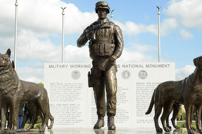 The newly unveiled US Military Working Dog Teams National Monument is seen at Joint Base San Antonio-Lackland, in San Antonio, Texas Oct 28, 2013. -- PHOTO: REUTERS