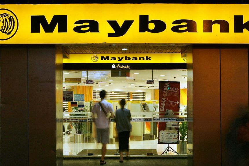 Customers enters a Malayan Banking Bhd (Maybank) branch in Kuala Lumpur, Malaysia, on Saturday, Aug 22, 2009. Malaysia's Malayan Banking Bhd, the country's largest lender, has launched an Islamic asset management unit to cater to growing investo