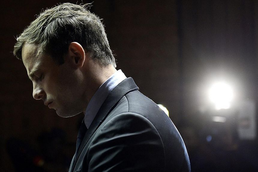 South African Paralympic sprinter Oscar Pistorius appears at the Magistrate Court in Pretoria on Aug 19, 2013. Pistorius faces two additional gun-related charges at his trial for the murder of his girlfriend, the prosecution said Tuesday. -- FI