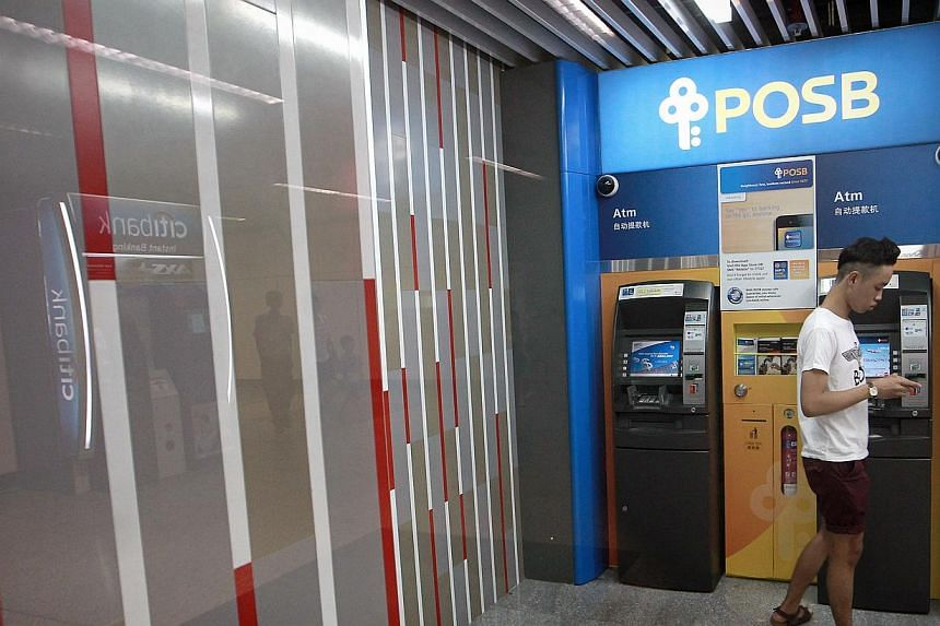 Generic photograph of members of the public using the POSB ATM at Braddell MRT Station on Oct 16, 2013. A filed engineer who was servicing automated teller machines (ATM) and cash deposit machines (CDM) was jailed for four months on Wednesday for che