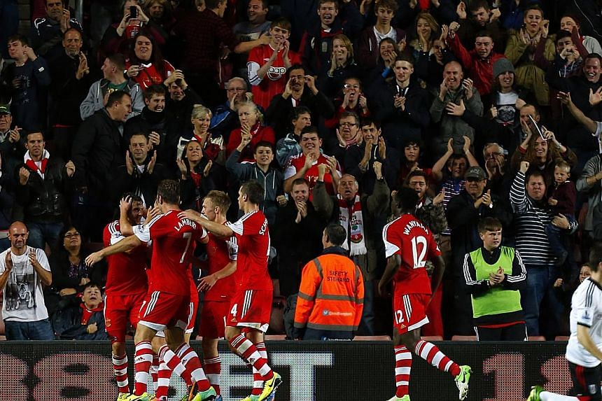 Southampton's Jay Rodriguez, centre, partially seen, celebrates scoring his side's second goal with his teammates during the English Premier League soccer match between Southampton and Fulham at St Mary's, Southampton, England, Saturday, Oct. 26, 201