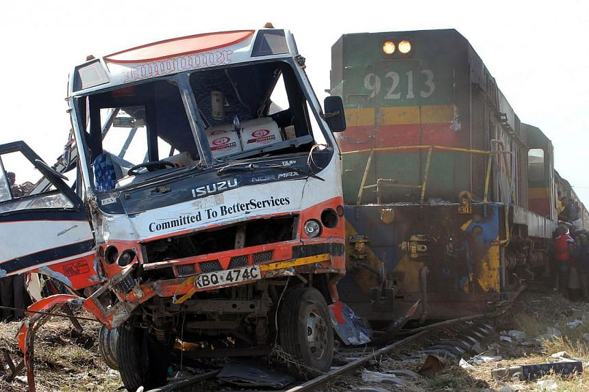 The wreckage of a minibus that was involved in an accident with a passenger train in Nairobi is pictured, on Oct 30, 2013. -- FILE PHOTO: AFP
