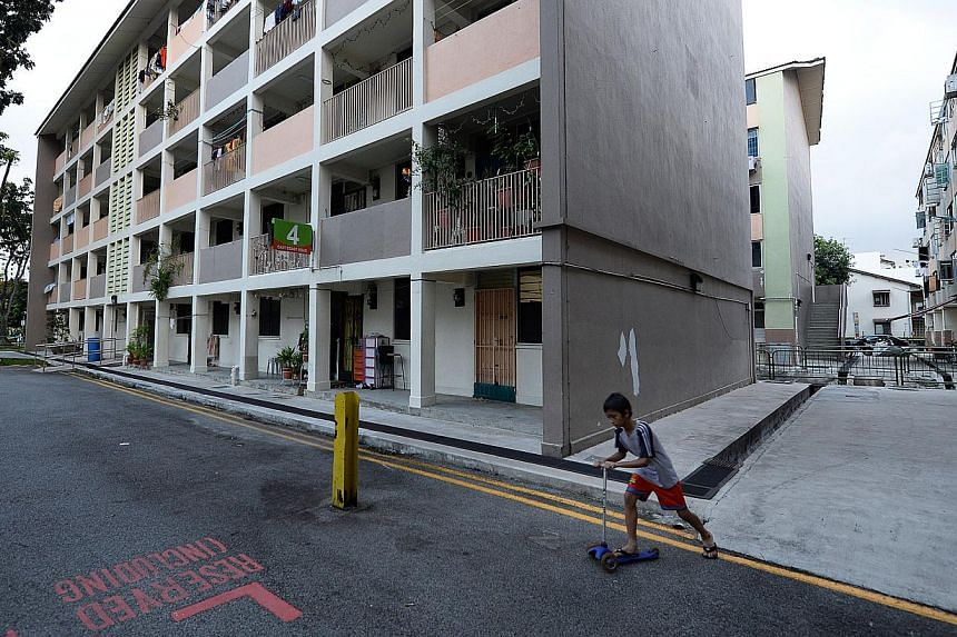 Mr Lee Tien Hee, 82, has lived in an HDB flat in Joo Chiat since 1964, but will move out when the blocks (above) are demolished, making Joo Chiat the first all-private-property constituency in Singapore. -- ST PHOTOS: RAJ NADARAJAN