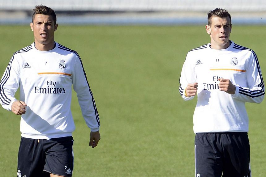 Real Madrid's Welsh forward Gareth Bale (right) and Real Madrid's Portuguese forward Cristiano Ronaldo (left) take part in a training session at the Valdebebas training ground in Madrid on Oct 29, 2013. New Real Madrid signing Gareth Bale joined team