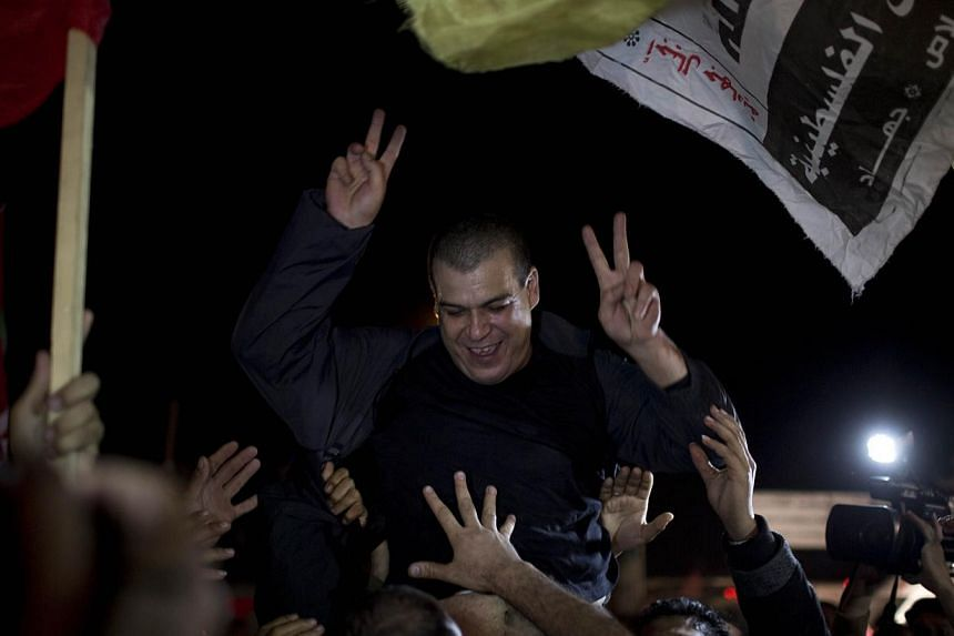 A released Palestinian prisoner reacts upon his arrival at the Erez crossing between Israel and the northern Gaza Strip on Oct 30, 2013. Israel freed 26 veteran Palestinian prisoners on Wednesday, alongside US-brokered peace talks, AFP correspondents