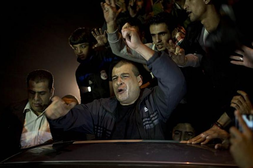 A released Palestinian prisoner reacts upon his arrival at the Erez crossing between Israel and the northern Gaza Strip on Oct 30, 2013. -- PHOTO: AFP