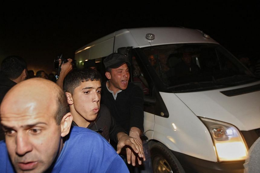 Palestinians welcome the released prisoners on a vehicle outside Ofer prison near the West Bank town of Ramallah, early on Wednesday, Oct 30, 2013. -- PHOTO: AP