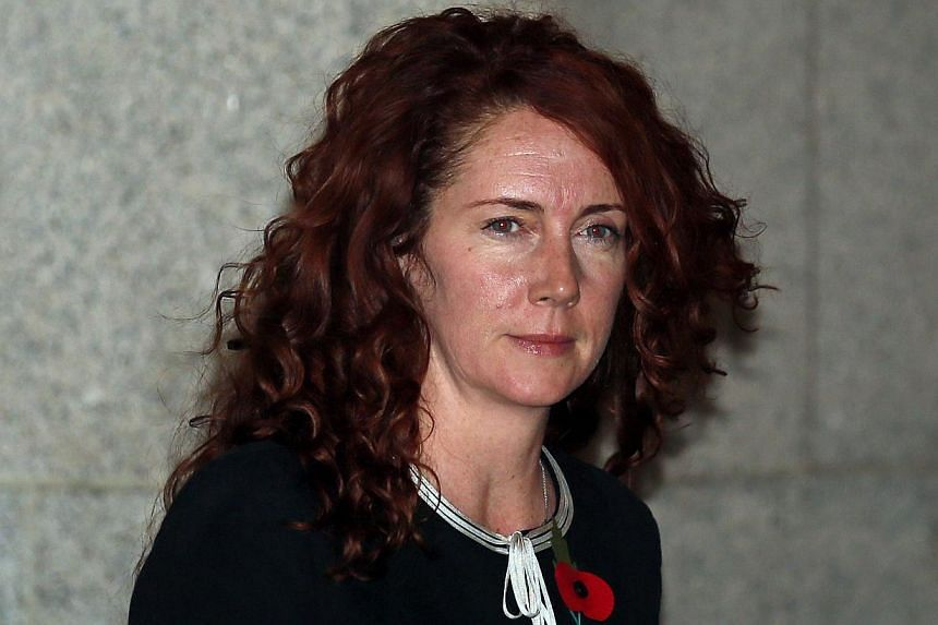 Former News International chief executive Rebekah Brooks leaves the Old Bailey courthouse in London October 29, 2013.A jury was sworn in Tuesday for Britain's phone-hacking trial, which is set to hear explosive evidence of the scandal tha