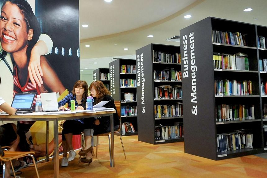 Students study at the APMI Kaplan's in-house library. Private education institutions (PEI) will have less administrative burdens and compliance costs the end of this year, the Council for Private Education, which regulates private schools in Singapor