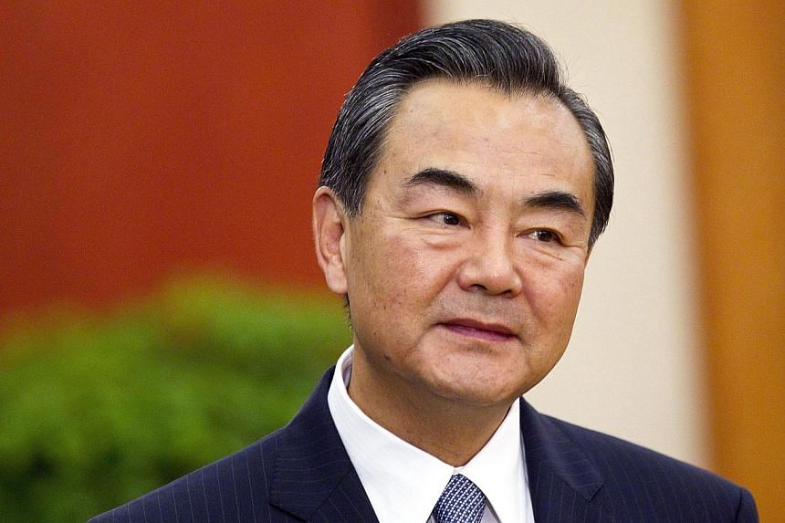 "Chinese Foreign Minister Wang Yi held ""candid"" talks last week with a visiting delegation from Tokyo, the government said on Wednesday after a report that the encounter involved a former Japanese premier. -- FILE PHOTO: AP"