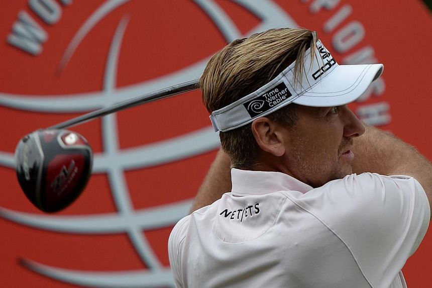 """Ryder Cup hero Ian Poulter tees off at the 10th hole during the pro-am event for the WGC-HSBC Champions tournament at the Shanghai Sheshan International Golf Club on Wednesday, Oct 30, 2013.Poulter feels that top players are """"pressured"""" into pl"""
