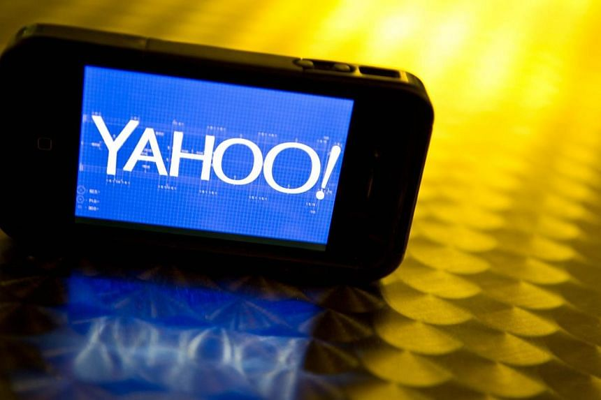 This September 12, 2013 photo illustration shows the newly designed Yahoo logo seen on a smartphone.The United States (US) National Security Agency has tapped into key communications links from Yahoo and Google data centers around the world, th