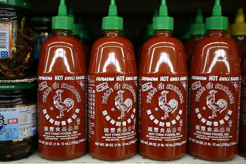 Bottles of Sriracha hot chili sauce, made by Huy Fong Foods, are seen on a supermarket shelf in San Gabriel, California on Oct 30, 2013. A row over spicy smells wafting from a US food factory is threatening to halt production of the popular Sriracha