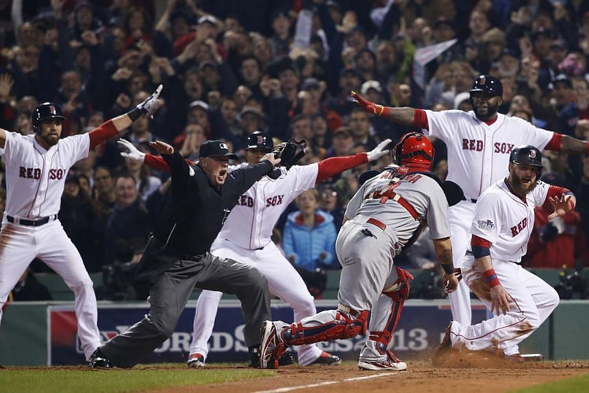 St. Louis Cardinals catcher Yadier Molina looks back as home plate umpire Jim Joyce calls Boston Red Sox's Jonny Gomes safe on a three-run double by Shane Victorino during the third inning of Game 6 of baseball's World Series on Wednesday, Oct 30, 20