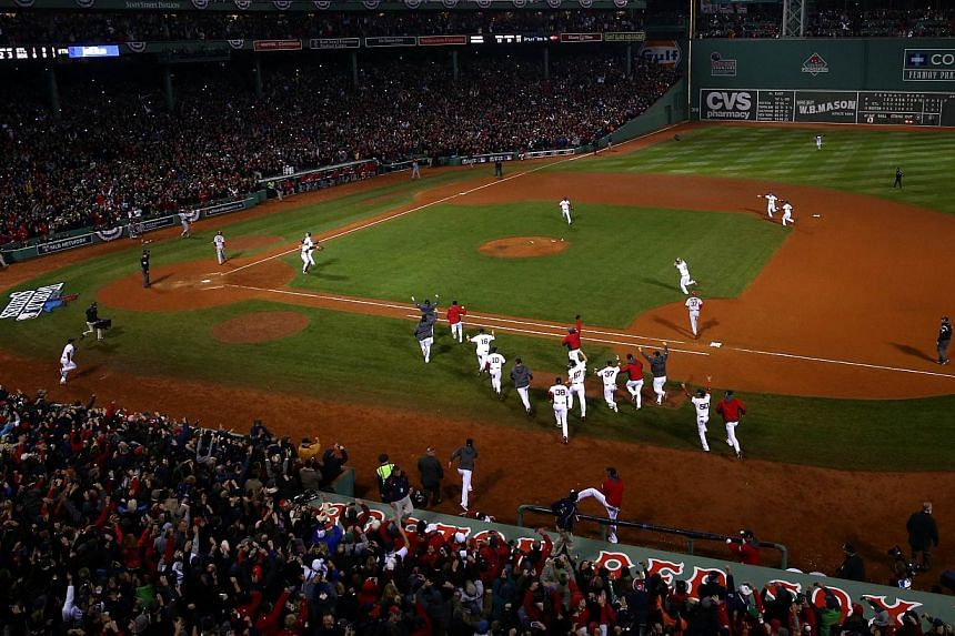The Boston Red Sox celebrate after defeating the St. Louis Cardinals in Game Six of the 2013 World Series at Fenway Park on Oct 30, 2013 in Boston, Massachusetts. -- PHOTO: AFP