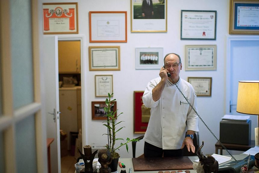 French Elysee presidential palace chef, Bernard Vaussion, speaks on the phone during his last day before retiring, on Oct 31, 2013, at the Elysee palace in Paris. Mr Bernard Vaussion has built up a comprehensive picture of the culinary tastes of six